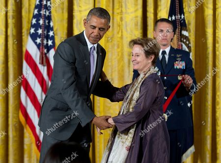 Barack Obama, Alice Waters President Barack Obama holds 2014 National Humanities Medal recipient chef, author, and advocate Alice Waters of Berkeley, Calif., during a ceremony in the East Room at the White House in Washington