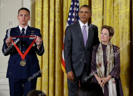 Barack Obama, Alice Waters President Barack Obama awards the 2014 National Humanities Medal to chef, author, and advocate Alice Waters of Berkeley, Calif., during a ceremony in the East Room at the White House in Washington