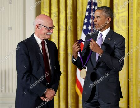 Barack Obama, Tobias Wolff President Barack Obama awards the 2014 National Medal of Arts to author and educator Tobias Wolff of Stanford, Calif., during a ceremony in the East Room at the White House in Washington