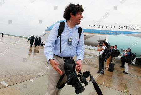 Stock Photo of Arun Chaudhary White House videographer Arun Chaudhary stands in front of Air Force One after he accompanied President Barack Obama on his visit to the Gulf Coast region affected by the BP Deepwater Horizon oil spill