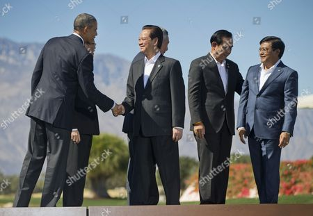 Barack Obama President Barack Obama shakes hands with Vietnam Prime Minister Nguyen Tan Dung, after posing for a group photo with other leaders of ASEAN, the 10-nation Association of Southeast Asian Nations, at the Annenberg Retreat at Sunnylands in Rancho Mirage, Calif. Also on stage are, Philippines President Benigno Aquino III, Singapore Prime Minister Lee Hsien Loong, Thailand Prime Minister Prayuth Chan-ocha, and Myanmar Vice President Nyan Tun