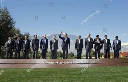 Barack Obama, General Le Luong Minh, Hassanal Bolkiah, Hun Sen, Joko Widodo, Najib Razak, Choummaly Sayasone, Benigno Aquino III, Lee Hsien Loong, Prayuth Chan-ocha, Nguyen Tan Dung, Nyan Tun President Barack Obama, center, waves as he poses for a group photo with leaders of ASEAN, the 10-nation Association of Southeast Asian Nations, at the Annenberg Retreat at Sunnylands in Rancho Mirage, Calif., . ASEAN's Secretary General Le Luong Minh Brunei's Sultan Hassanal Bolkiah, Cambodia's Prime Minister Hun Sen, Indonesian President Joko Widodo, Malaysia Prime Minister Najib Razak, Laos President Choummaly Sayasone, Philippine President Benigno Aquino III, Singapore Prime Minister Lee Hsien Loong, Thailand Prime Minister Prayuth Chan-ocha, Vietnam Prime Minister Nguyen Tan Dung, and Myanmar Vice President Nyan Tun