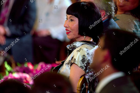 Amy Tan Author Amy Tan listens as President Barack Obama makes remarks at an Asian American and Pacific Islander (AAPI) Heritage Month event in the East Room of the White House in Washington