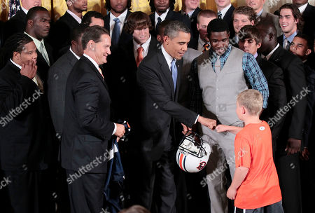 Barack Obama, Gene Chizik, Jay Jacobs, Cam Newton, Nick Fairley President Barack Obama, center, fist bumps Ethan Gibbs, right, son of former White House Press Secretary Robert Gibbs, in the East of the White House in Washington, during a ceremony honoring the 2010 NCAA BCS Football Champion Auburn Tigers. Looking on are Auburn head coach Gene Chizik, left, and player Kodi Burns, right