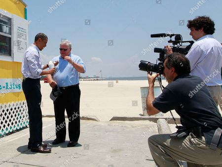 Stock Image of Barack Obama, Haley Barbour, Arun Chaudhary, Pete Souza President Barack Obama and Mississippi Gov. Haley Barbour are photographed by White House photographer Pete Souza and White House videographer Arun Chaudhary as they visit Cyndi's Sno-De-Lites in Gulfport, Miss., after meeting with residents affected by the BP Deepwater Horizon oil spill