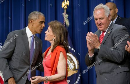 Stock Picture of Barack Obama, John Shimkus, Bonnie Lautenberg President Barack Obama, greets Bonnie Lautenberg, widow of the Sen. Frank Lautenberg, before signing the Lautenberg Chemical Safety for the 21st Century Act., during a ceremony at the Eisenhower Executive Office Building on the White House complex in Washington. At right is Rep. John Shimkus, R-Ill