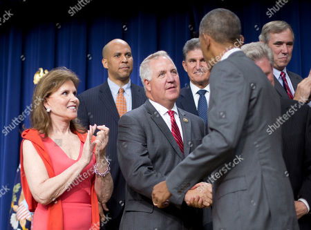 Barack Obama, John Shimkus, Bonnie Lautenberg President Barack Obama shakes hands with Rep. John Shimkus, R-Ill., center, after signing bill H.R. 2576, the Frank R. Lautenberg Chemical Safety for the 21st Century Act., during a ceremony at the Eisenhower Executive Office Building on the White House complex in Washington. At left is Bonnie Lautenberg, widow of the Sen. Frank Lautenberg