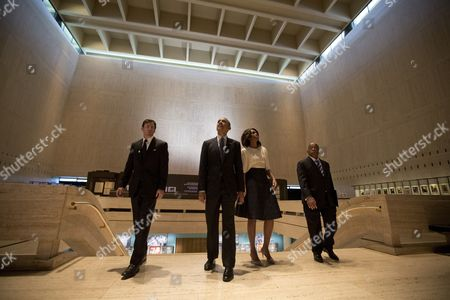 Barack Obama, Michelle Obama, Mark Updegrove, John Lewis From left, LBJ Presidential Library Director Mark Updegrove, President Barack Obama, first lady Michelle Obama and Rep. John Lewis, D-Ga., arrive in the Great Hall at the LBJ Presidential Library in Austin, Texas, before attending a Civil Rights Summit to commemorate the 50th anniversary of the signing of the Civil Rights Act