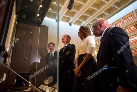 Barack Obama, Michelle Obama, Mark Updegrove, John Lewis From left, LBJ Presidential Library Director Mark Updegrove, President Barack Obama, first lady Michelle Obama and Rep. John Lewis, D-Ga., tour and exhibit in the Great Hall at the LBJ Presidential Library in Austin, Texas, as they attend a Civil Rights Summit to commemorate the 50th anniversary of the signing of the Civil Rights Act