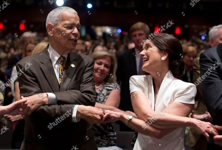 """Julian Bond, Luci Baines Johnson Social activist Julian Bond, and leader in the American civil rights movement, and Luci Baines Johnson, the younger daughter of President Lyndon Baines Johnson, join hands as they sing """"We Shall Overcome"""" before President Barack Obama spoke at the LBJ Presidential Library, in Austin, Texas, during the Civil Rights Summit to commemorate the 50th anniversary of the signing of the Civil Rights Act"""