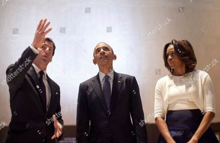 Barack Obama, Michelle Obama, Mark Updegrove LBJ Presidential Library Director Mark Updegrove, left, speaks to President Barack Obama and first lady Michelle Obama as they tour the Great Hall at the LBJ Presidential Library, in Austin, Texas, as they attend a Civil Rights Summit to commemorate the 50th anniversary of the signing of the Civil Rights Act