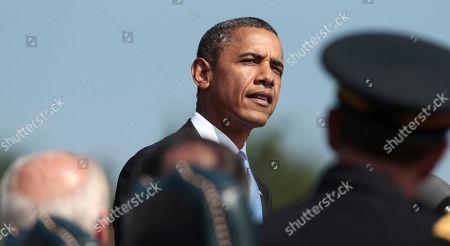 Barack Obama President Barack Obama speaks on the killing of US-born Imam Anwar al-Awlaki in Yemen, during a 'Change of Office' ceremony at Ft. Myer in Arlington, Va