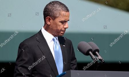Barack Obama President Barack Obama pauses as he speaks on the killing of US-born Imam Anwar al-Awlaki in Yemen, during a 'Change of Office' ceremonies at Ft. Myer in Arlington, Va