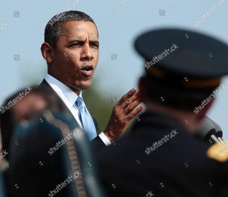 Barack Obama President Barack Obama speaks on the killing of US-born Imam Anwar al-Awlaki in Yemen, during a 'Change of Office' ceremonies at Ft. Myer in Arlington, Va