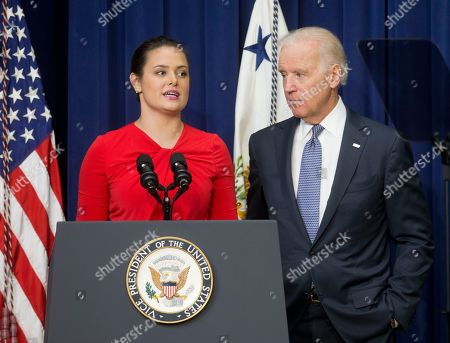 Stock Photo of Joe Biden, Madeleine Smith Vice President Joe Biden listens as Madeleine Smith recounts her story of being a raped victim while a student at Harvard University, during an event announcing the release of the First Report of the White House Task Force to Protect Students from Sexual Assault, in the South Court Auditorium of the Eisenhower Executive Office Building on the White House complex in Washington. The White House is urging schools to provide victims of sexual assault with a confidential, respectful way to report the crimes and seek treatment