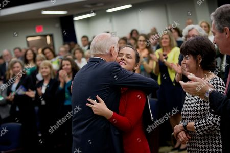 Joe Biden, Madeleine Smith Vice President Joe Biden hugs Madeleine Smith after he spoke about the release of the First Report of the White House Task Force to Protect Students from Sexual Assault, in the South Court Auditorium of the Eisenhower Executive Office Building on the White House complex in Washington. Earlier Smith had recounted her story of being a raped victim while a student at Harvard University in Boston. The White House is urging schools to provide victims of sexual assault with a confidential, respectful way to report the crimes and seek treatment