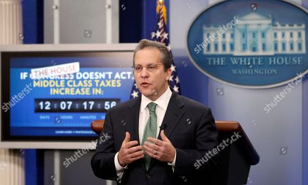 Stock Photo of Gene B. Sperling Gene B. Sperling, director of the National Economic Council and assistant to the President for Economic Policy, speaks during a television interview, in the White House Brady Briefing Room in in Washington