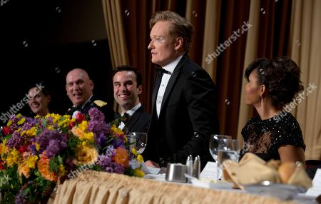 Christi Parsons, White House correspondent for the Chicago Tribune, Los Angeles Times and Tribune newspaper chain, from left, Chief of Staff Gen. Raymond T. Odierno, Michael Scherer, White House correspondent for TIME, late-night television host Conan O'Brien and first lady Michelle Obama attend the White House Correspondents' Association Dinner at the Washington Hilton Hotel, in Washington