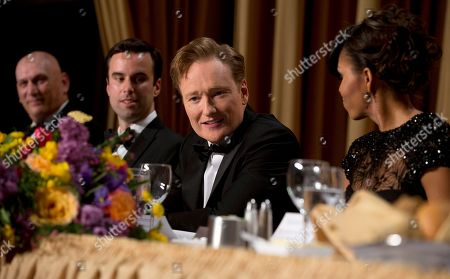 Chief of Staff Gen. Raymond T. Odierno, from left, Michael Scherer, White House correspondent for TIME, late-night television host Conan O'Brien and first lady Michelle Obama attend the White House Correspondents' Association Dinner at the Washington Hilton Hotel, in Washington