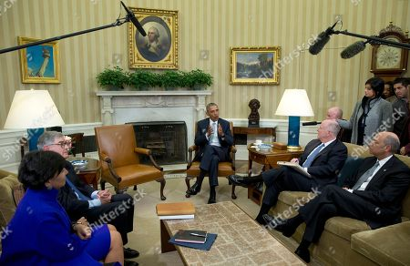 Barack Obama, Jeh Johnson, Tom Donilon, Penny Pritzker President Barack Obama, joined by from left, Commerce Secretary Penny Pritzker, former IBM CEO Sam Palmisano, former National Security Adviser Tom Donilon, and Homeland Security Secretary Jeh Johnson, talks to media in the Oval Office of the White House in Washington, at the bottom of a meeting. Donilon, and Palmisano, are being appointed as the Chair and Vice Chair, respectively, of the Commission on Enhancing National Cybersecurity