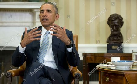 Barack Obama President Barack Obama talks to media in the Oval Office of the White House in Washington, at the bottom of a meeting, where he announced that former IBM CEO Sam Palmisano, former National Security Adviser Tom Donilon are being appointed as the Chair and Vice Chair, respectively, of the Commission on Enhancing National Cybersecurity