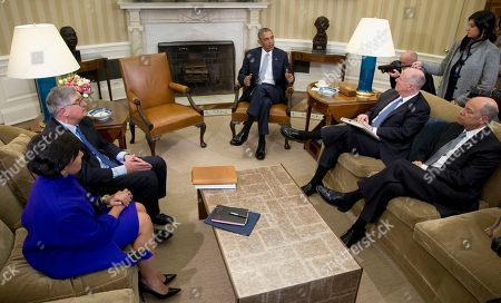 Stock Image of Barack Obama, Jeh Johnson, Tom Donilon, Penny Pritzker President Barack Obama, joined by from left, Commerce Secretary Penny Pritzker, former IBM CEO Sam Palmisano, former National Security Adviser Tom Donilon, and Homeland Security Secretary Jeh Johnson, talks to media in the Oval Office of the White House, in Washington, at the bottom of a meeting. Donilon, and Palmisano, are being appointed as the Chair and Vice Chair, respectively, of the Commission on Enhancing National Cybersecurity