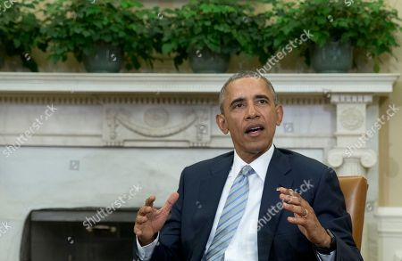 Barack Obama President Barack Obama talks to media in the Oval Office of the White House, in Washington, at the bottom of a meeting, where he announced that former IBM CEO Sam Palmisano, former National Security Adviser Tom Donilon are being appointed as the Chair and Vice Chair, respectively, of the Commission on Enhancing National Cybersecurity