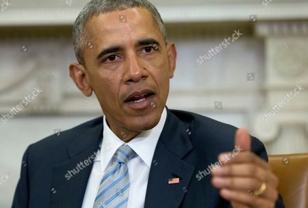 Stock Photo of Barack Obama President Barack Obama talks to media in the Oval Office of the White House in Washington, at the bottom of a meeting, where he announced that former IBM CEO Sam Palmisano, former National Security Adviser Tom Donilon are being appointed as the Chair and Vice Chair, respectively, of the Commission on Enhancing National Cybersecurity