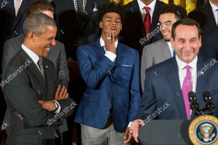 Barack Obama, Mike Krzyzewski Duke Blue Devils guard and co-captain Quinn Cook, center, jokingly shows off his championship ring as Duke head coach Mike Krzyzewski, right, accompanied by President Barack Obama, left, speaks in the East Room of the White House in Washington, during a ceremony honoring the NCAA Champion Duke Blue Devils men's basketball team