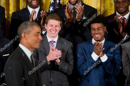 Barack Obama, Quinn Cook, Sean Kelly Duke Blue Devils guard and co-captain Quinn Cook, right, and guard Sean Kelly, second from left, accompanied by President Barack Obama, left, applaud in the East Room of the White House in Washington, during a ceremony honoring the NCAA Champion Duke Blue Devils men's basketball team