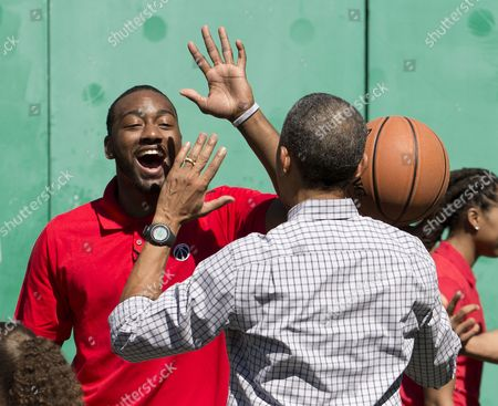 Barack Obama, John Wall Washington Wizards basketball player John Wall, right, congratulates President Barack Obama as they play on the basketball court on the South Lawn of the White House in Washington during the White House Easter Egg Roll . Thousands of children gathered at the White House for the annual Easter Egg Roll. This year's event features live music, cooking stations, storytelling, and of course, some Easter egg roll