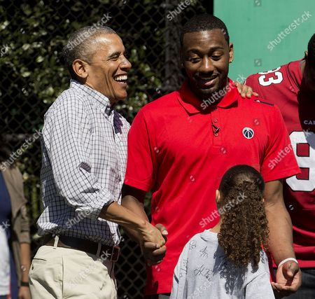 Barack Obama, John Wall President Barack Obama greets Washington Wizards basketball player John Wall before participating in a game on the basketball court on the South Lawn of the White House in Washington during the White House Easter Egg Roll, . Thousands of children gathered at the White House for the annual Easter Egg Roll. This year's event features live music, cooking stations, storytelling, and of course, some Easter egg roll