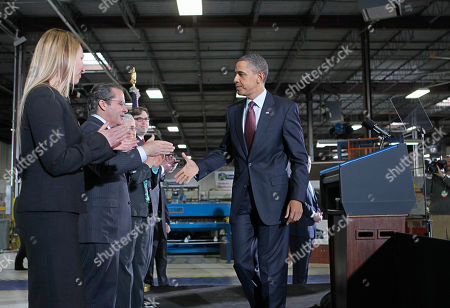 Barack Obama, Heather Higginbottom, Gene Sperling, Katharine G. Abraham, Jason Furman With a factory floor as a backdrop, President Barack Obama shakes hands with Gene Sperling, the new head of the National Economic Council, as other members of his his economic team look, after comments on nation's latest unemployment reports, at Thompson Creek Manufacturing in Landover, Md. From left are: Heather Higginbottom, to be deputy director of the Office of Management and Budget; Sperling; Katharine G. Abraham to the Council of Economic Advisers; and Jason Furman to deputy at the NEC