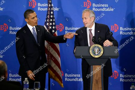 Barack Obama, Jim McNerney President Barack Obama points after the podium microphone stopped working while he was being introduced by Jim McNerney, chief executive officer of The Boeing Company, before speaking about the fiscal cliff during an address before the Business Roundtable, an association of chief executive officers, in Washington