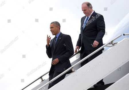 Barack Obama, Dan Kildee President Barack Obama, followed by Rep. Dan Kildee, D-Mich., arrives on Air Force One at Bishop International Airport in Flint, Mich., . The president is in Flint, Mich., to discuss the ongoing water crisis