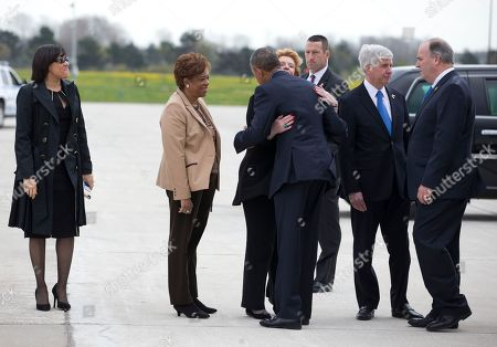 Barack Obama, Karen Weaver, Rick Snyder, Debbie Stabenow, Brenda Lawrence From left, Flint, Mich. Mayor Karen Weaver, Rep. Brenda Lawrence, D-Mich., President Barack Obama Sen. Debbie Stabenow, D-Mich., Michigan Gov. Rick Snyder and Rep. Dan Kildee, D-Mich., greet each other on the tarmac as the president arrives on Air Force One at Bishop International Airport in Flint, Mich., . The president is in Flint, Mich., to discuss the ongoing water crisis