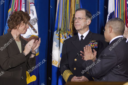 "Stock Picture of Mike Mullen, Zoe Dunning, Eric Alva Former Navy Commander Zoe Dunning, left, and former Marine Staff Sgt. Eric Alva, right, applaud Joint Chiefs Chairman Adm. Mike Mullen, at the Interior Department in Washington, where President Barack Obama signed the ""don't ask, don't tell"" repeal legislation that would allow gays to serve openly in the military"