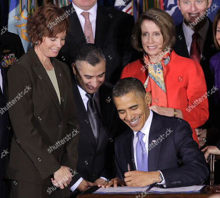 Barack Obama, Zoe Dunning, Eric Alva, Nancy Pelosi President Barack Obama signs the Don't Ask, Don't Tell Repeal Act of 2010, at the Interior Department in Washington. From left are, Commander Zoe Dunning, Marine Staff Sgt. Eric Alva, and House Speaker Nancy Pelosi of Calif