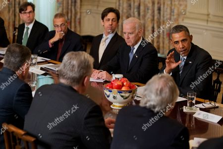 Barack Obama, Joe Biden President Barack Obama meets with members of the Democratic Governors Association, in the State Dining Room of the White House in Washington. From left are, Chairman of the Council of Economic Advisers Jason Furman, White House counselor John Podesta, David Simas, Deputy Senior Advisor for Communications and Strategy, Vice President Joe Biden and the president