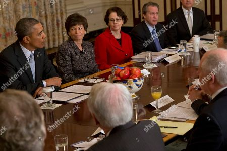 Stock Picture of Barack Obama, Valerie Jarrett, Cecilia Muñoz, Gene Sperling President Barack Obama meets with members of the Democratic Governors Association, in the State Dining Room of the White House in Washington. From left are, the president Senior White House Adviser Valerie Jarrett, director of the White House Domestic Policy Council Cecilia Muñoz, and director of the National Economic Council Gene Sperling