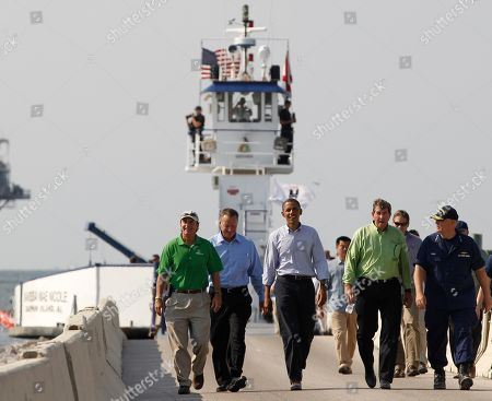 Barack Obama President Barack Obama, center, steps off the ferry from Dauphin Island, Ala., to Fort Morgan, Ala., as he visits the Gulf Coast region affected by the BP Deepwater Horizon oil spill . From left to right: Mayor of Gulf Shores Robert Craft; Mayor of Dauphin Island Jeff Collier; Alabama Gov. Bob Riley; and National Incident Commander Adm. Thad Allen