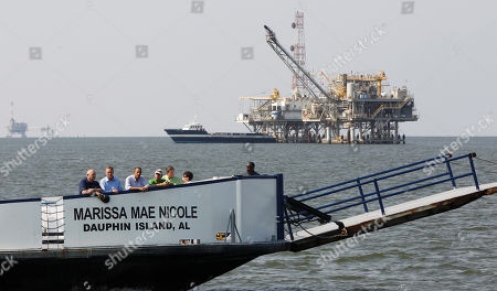 Barack Obama A natural gas rig is seen at rear as President Barack Obama, third from left, takes a ferry from Dauphin Island, Ala., to Fort Morgan, Ala., as he visits the Gulf Coast region affected by the BP Deepwater Horizon oil spill . From left, National Incident Commander Adm. Thad Allen; Mayor of Dauphin Island Jeff Collier; Obama; Mayor of Gulf Shores Robert Craft; Alabama Gov. Bob Riley; and senior adviser Valerie Jarrett