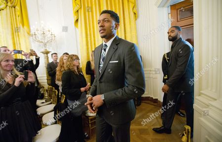 Stock Photo of Bradley Beal, Alan Anderson Washington Wizards basketball players Bradley Beal, center, and Alan Anderson, right, arrive in the East Room of the White House in Washington, to listen to President Barack Obama talk about steps his administration is taking to reduce gun violence. Also on stage are stakeholders, and individuals whose lives have been impacted by the gun violence