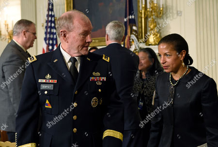 Stock Photo of Martin Dempsey, Susan Rice Chairman of the Joint Chiefs of Staff Gen. Martin E. Dempsey, second from left, talks with National Security Advisor Susan Rice, right, following President Barack Obama's announcement that Defense Secretary Chuck Hagel was resigning during an event in the State Dining Room of the White House in Washington, . Hagel is stepping down under pressure from Obama's Cabinet, senior administration officials said Monday, following a tenure in which he has struggled to break through the White House's insular foreign policy team