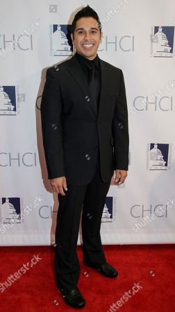Stock Image of Erik Rivera Comedian Erik Rivera poses on the red carpet as he arrives at the Congressional Hispanic Caucus Institute's 33rd Annual Awards Gala at the Washington Convention Center in Washington