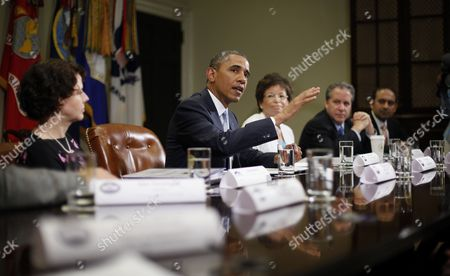 Barack Obama, Cecilia Muñoz, Valerie Jarrett, Gene Sperling, Dilawar Syed President Barack Obama speaks during his meeting in the Roosevelt Room of the White House in Washington, with CEOs, business owners and entrepreneurs to discuss immigration reform. From left are, Cecilia Muñoz, direcor of the White House Domestic Policy Council, the president, senior White House adviser Valerie Jarrett, National Economic Council Director Gene Sperling, and Dilawar Syed, CEO Yonja Media Group. Obama hosted the meeting to discuss the importance of commonsense immigration reform including the Congressional Budget Office analysis that concludes immigration reform would promote economic growth and reduce the deficit