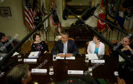Barack Obama, Cecilia Muñoz, Valerie Jarrett, Gene Sperling, Alex Torrenegra President Barack Obama, center, during his meeting in the Roosevelt Room of the White House in Washington with CEOs, business owners and entrepreneurs to discuss immigration reform, . Seated with Obama are from left to right, Alex Torrenegra, Founder, VoiceBunny and WeHostels, Cecilia Muñoz, Dir. of the White House Domestic Policy Council, Valerie Jarrett, Senior White House Advisor, and Gene Sperling, National Economic Council Director. Obama hosted the meeting to discuss the importance of commonsense immigration reform including the Congressional Budget Office analysis that concludes immigration reform would promote economic growth and reduce the deficit