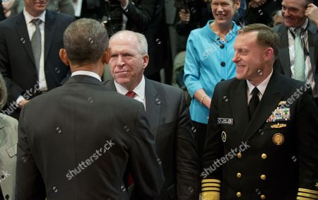 Barack Obama, John O. Brennan, Michael S. Rodgers President Barack Obama, left, greets John O. Brennan, center, Dir. of the Central Intelligence Agency (CIA), and Admiral Michael S. Rogers, right, Dir. of National Security Agency/Central Security Service (NSA/CSS), after speaking at the Office of the Director of National Intelligence's (ODNI) 10th anniversary at ODNI headquarters in McLean, Va., . The president told members of the intelligence community that he appreciates their service and understands they don't take their work lightly