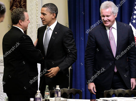 Barack Obama, Bill Daley, Jeffrey Immelt President Barack Obama shakes hands with Robert Wolf, from UBS Group America, left, as GE Chairman as Jeffrey Immelt looks on at right, during a meeting of his Council on Jobs and Competitiveness, in the Eisenhower Executive Office Building on the White House complex in Washington