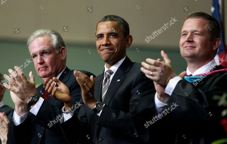 Barack Obama, C.J. Huff, Jay Nixon President Barack Obama, center, with Missouri Gov. Jay Nixon, left, and Superintendent C.J. Huff, right, applaud the Class of 2012 at the Joplin High School commencement ceremony, at Missouri Southern State University in Joplin, Mo